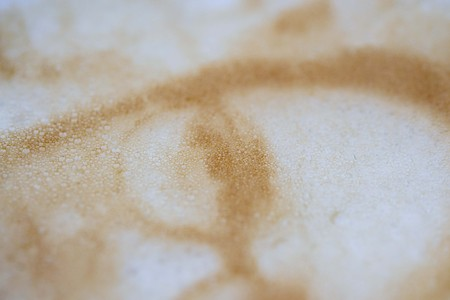Drawing of a womans face on a foam coffee latte in a glass created by a 3D printer close-up. 3d printer created a portrait of a girl on the foam of brewed coffee