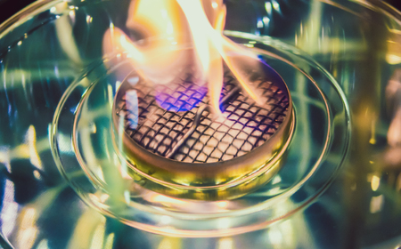 Modern bio fireplot fireplace on ethanol gas. Flame gas stove close-up. Smart ecological alternative technologies. Contemporary biofuel on ethanol. Energy saving innovation. Interior inside house