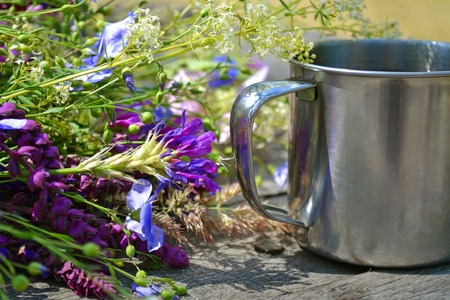many flowers with  camp mug of iron for tourism