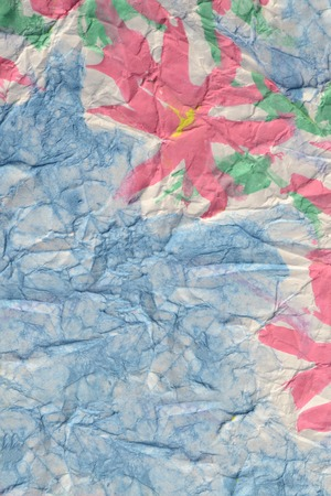 pink flowers painted paints on a crumpled blue paper