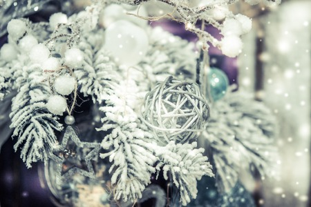 Christmas tree toys decorations and snow-covered Christmas tree branches close-up. Winter Christmas New Year background. Banco de Imagens