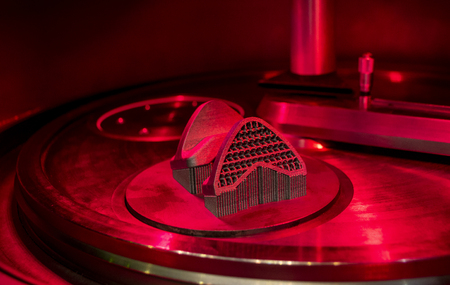 Object printed from metal powder on metal 3d printer, working chamber. Laser sintering machine for metal. Concept progressive additive DMLS, SLM, SLS 3d printing technology. 4.0 industrial revolution. Stock Photo