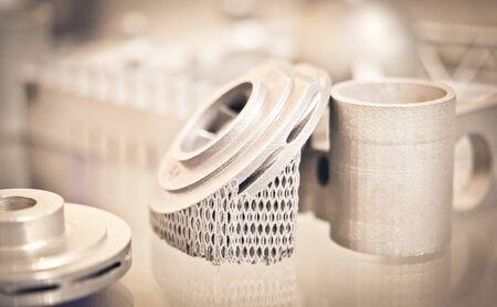 Object printed on metal 3d printer. A model created in a laser sintering machine close-up. DMLS, SLM, SLS technology. Concept of 4.0 industrial revolution. Progressive modern additive technology. 版權商用圖片
