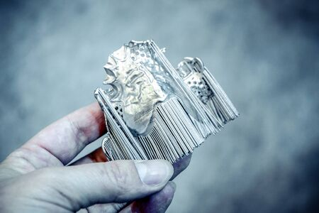 Man is holding object printed on metal 3d printer. Object printed in laser sintering machine. Modern 3D printer printing from metal powder. Progressive additive DMLS, SLM, SLS 3d printing technology