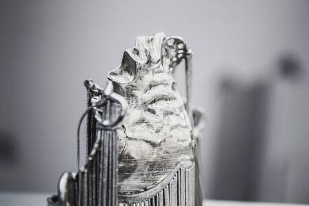 Object printed on metal 3d printer. Dental crowns printed in laser sintering machine. Modern 3D printer printing from metal powder. Concept progressive additive DMLS, SLM, SLS 3d printing technology