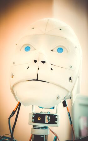 Face robot close-up. Face of an old robot made of white shabby plastic close-up Stock Photo