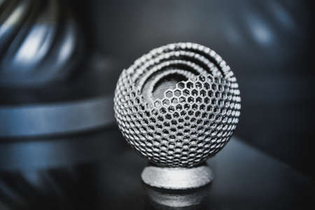 Object printed on metal 3d printer close-up. Object printed in laser sintering machine. Modern 3D printer printed from metal powder. Concept progressive additive DMLS, SLM, SLS 3d printing technology Stock Photo