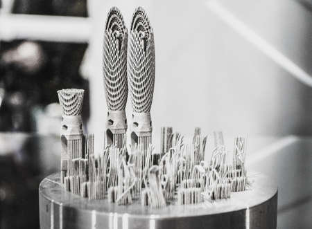 Object printed on metal 3d printer close-up. Object printed in laser sintering machine. Modern 3D printer printing from metal powder. Concept progressive additive DMLS, SLM, SLS 3d printing technology Stock Photo