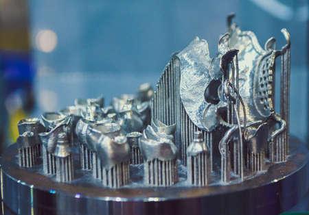 Object printed on metal 3d printer close-up. Object printed in laser sintering machine. Modern 3D printer printed from metal powder. Concept progressive additive DMLS, SLM, SLS