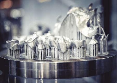 Object printed on metal 3d printer close-up. Object printed in laser sintering machine. Modern 3D printer printed from metal powder. Concept progressive additive DMLS, SLM, SLS 3d printing technology Standard-Bild
