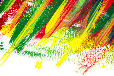 Background from different strokes of red, yellow, green and blue paint