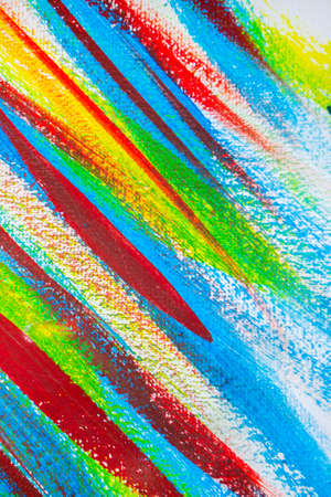 Many different multi-colored lines are chaotically drawn with brush