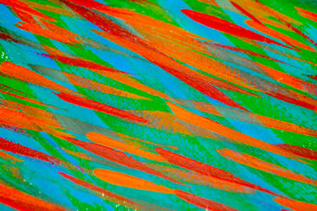 Bright varied background of colored lines of brush strokes made with paint