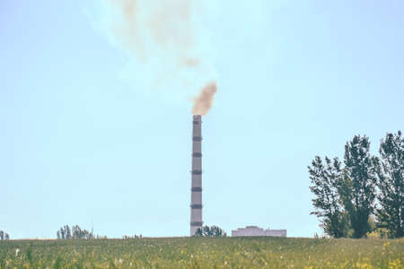 Pipe factory smoke in the field with clear sky Standard-Bild - 167190141