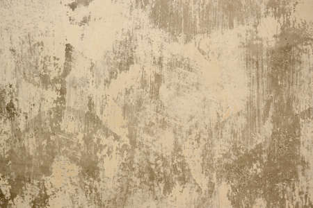 Beige background with dabs of whitewash