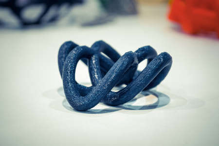Objects printed by 3d printer on white background. Standard-Bild
