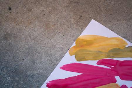 Abstract background brush strips blue, pink, yellow Standard-Bild - 166142835