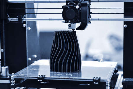 The process of working 3D printer and creating a three-dimensional object Stock Photo