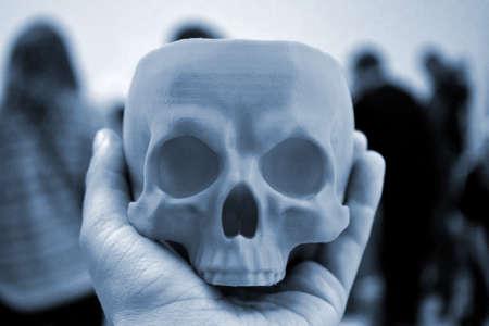 Skull printed on 3d printer in mans hand. Progressive modern