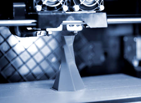 3D printer printing isolated volume triangular object blue gray color Standard-Bild