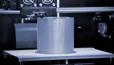 3D printer prints the form of molten plastic blue gray close-up. Standard-Bild