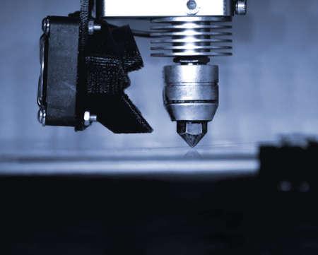 Modern 3D printer printing figure close-up. Automatic three dimensional Standard-Bild