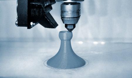Modern 3D printer printing figure blue colors close-up Standard-Bild