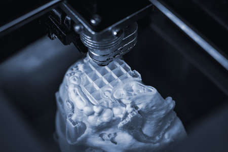 3D printer prints the form of molten plastic white.