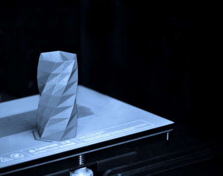 The object printed 3D printer on a blue and black background