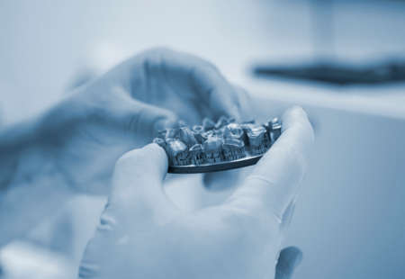 Man holds in hands object printed on metal 3d printer in laboratory.