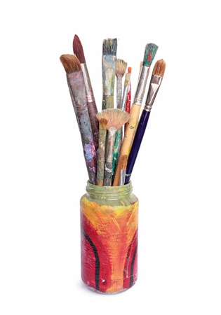 brush painting: Used artist brushes in a hand painted glass jar Stock Photo