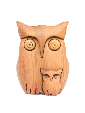 crafts person: Carved wooden owl with baby owl partly inside it.