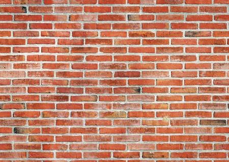 paredes de ladrillos: Pared de ladrillo rojo de fondo sin fisuras.