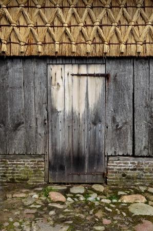 wood abandoned: Door of old wooden barn  Stock Photo