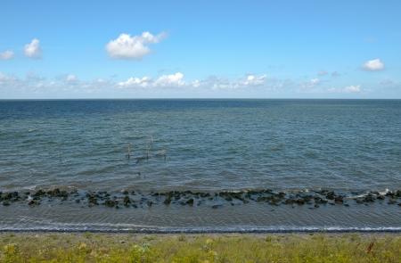 enclosing: Dutch Waddensea seen from the Afsluitdijk. Stock Photo