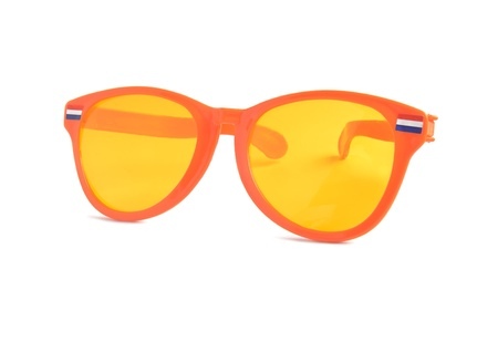 Large funny orange glasses with Dutch flags. photo