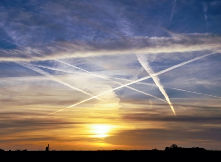 Evening sky in Holland with airplane vapour trails.