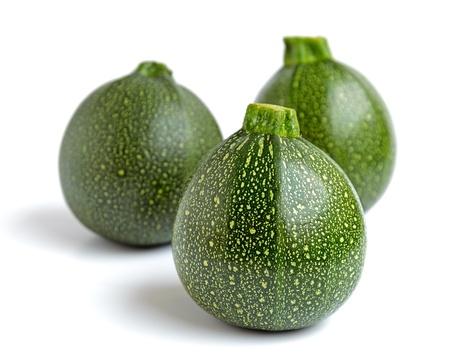 cucurbita: Three round courgettes or zucchinis (Cucurbita pepo) on a white background.