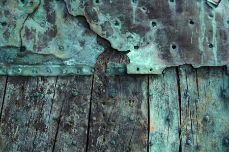 Oxidized copper and decayed wood  photo