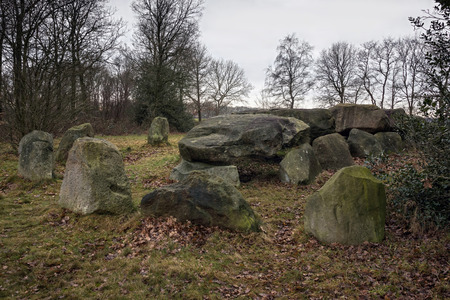 county side: Dolmen D50, an ancient megalithic tomb in the Netherlands on a cloudy day in winter.