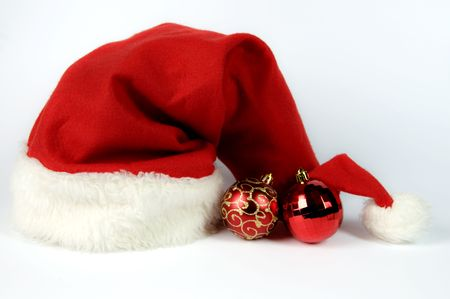 Red hat of Santa Claus  and balls on a white background photo