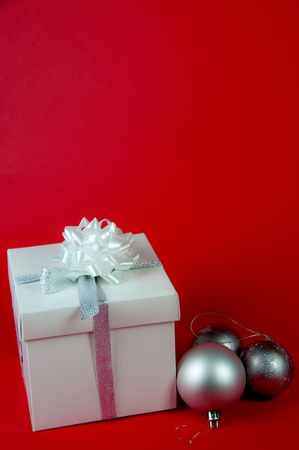 Gift bag with ribbon on a red and silver photo