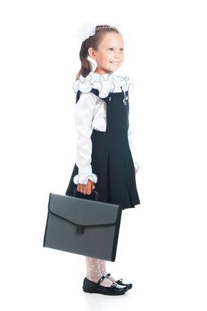 Écolière avec le sac à main dans la main sur un fond blanc