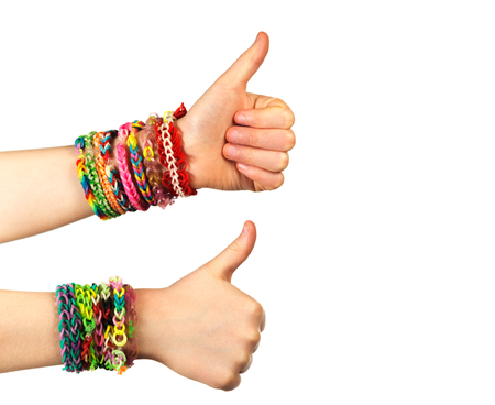 okey: Two hand with trendy handmade weaving bracelets show okey on a white background. Stock Photo