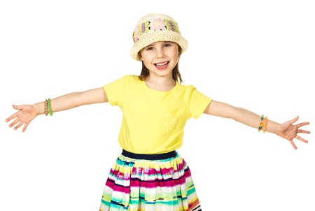 arms wide open: Cute little fashion girl in colorful summer clothes and hat open arms wide open Stock Photo