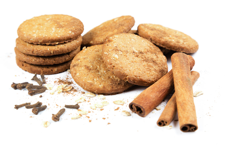 gritting: Cookies honey with nuts, cereals, cinnamon and cloves on a white background
