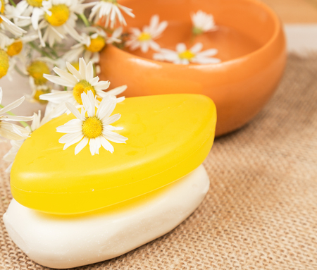 Chamomile handmade soaps with products for manufacturing Stock Photo
