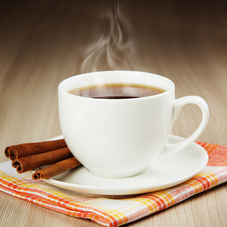 Hot cup of warming tea with cinnamon
