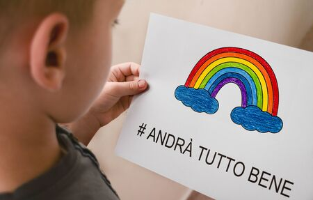 andra tutto bene, Everything is gonna be alright in hand drawing letters and a rainbow with clouds drawn by a child. quarantine corona virus flu, the covid 19. Archivio Fotografico