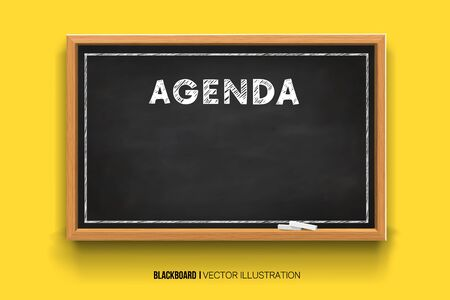 Hand writing the word Agenda with white Chalk inscription on a blackboard. Chalkboard 3D. Realistic black boards in a wooden frame isolated on a yellow background.